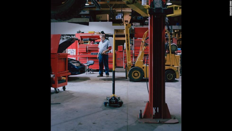 Viktor Arrington works on a car in his auto-repair shop.