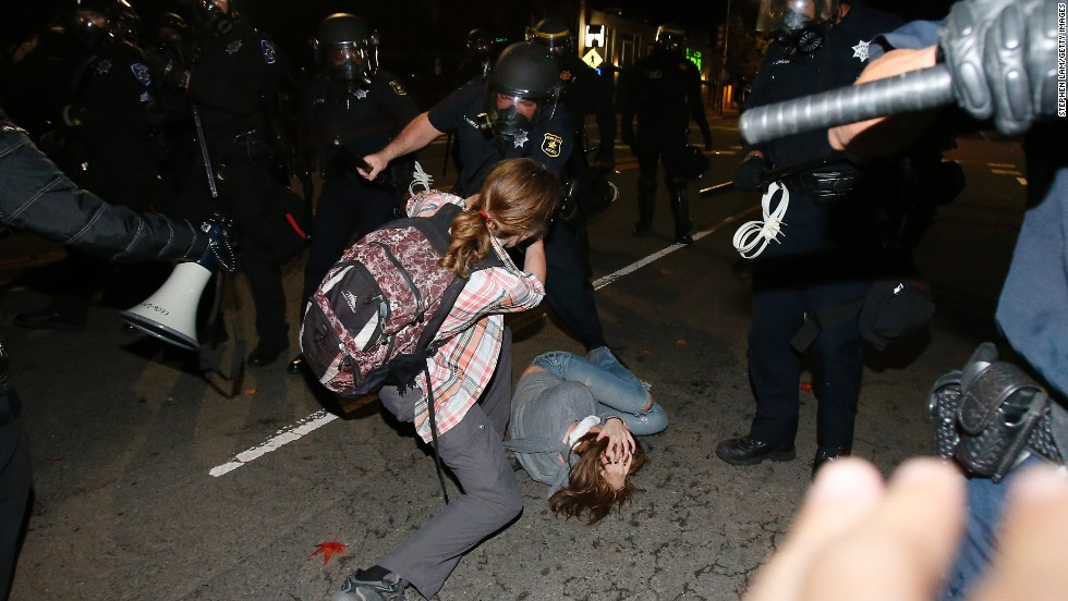 A police officer in Berkeley clashes with a protester on December 7.