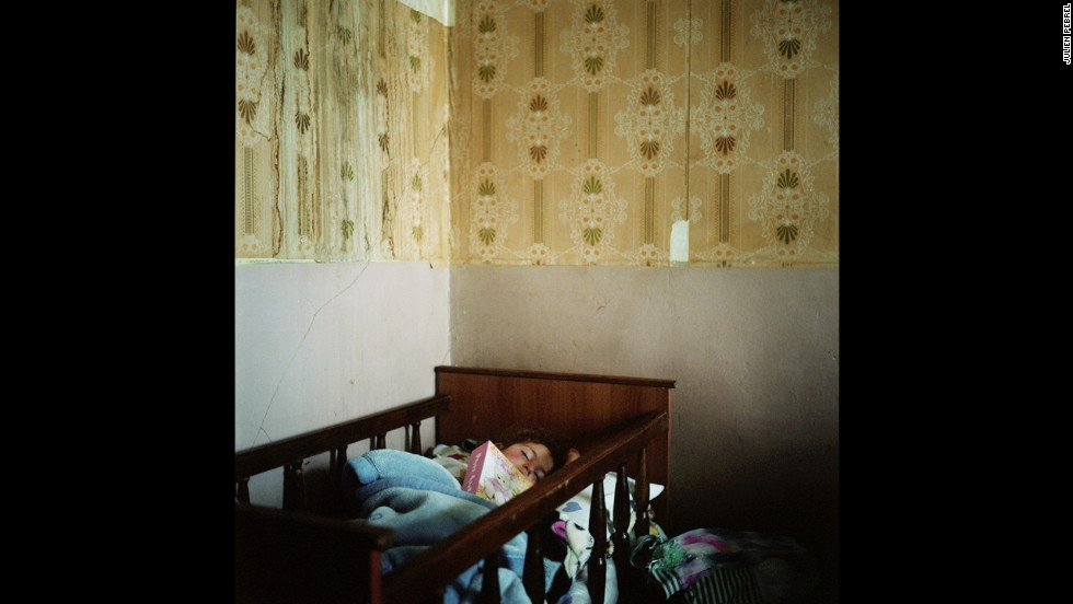 Lilith, Anoush's daughter, fell asleep with her father's photo album. He went to Russia to earn money so they could build a house in the village.