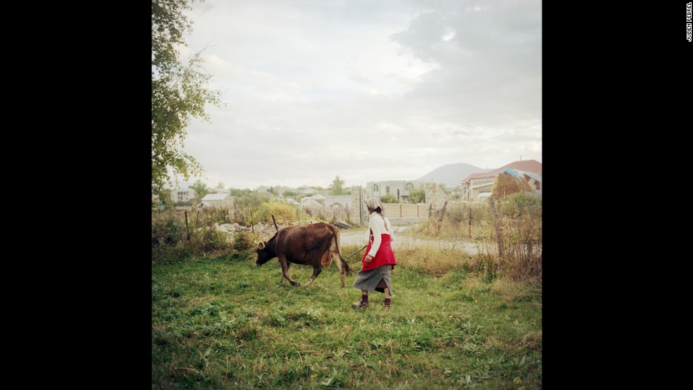 A woman named Cirush fetches her cow in the evening. Her husband and one of her sons work in Russia. Her other son is in the military.