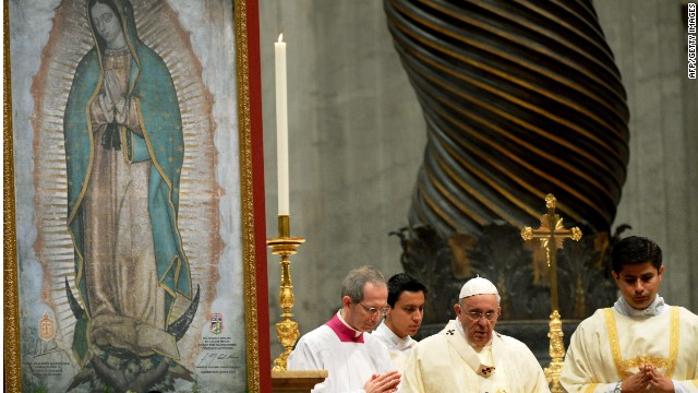 "Pope Francis (C) stands before the Our Lady of Guadalupe image on the altar, on December 12, 2014, in St. Peter's basilica at the Vatican as he presides a "" Creole Mass "" to mark the festivity of the Our Lady of Guadalupe. AFP PHOTO / VINCENZO PINTOVINCENZO PINTO/AFP/Getty Images"