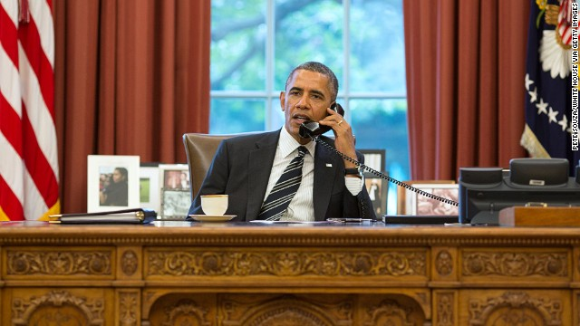 In this handout photo provided by the White House, President Barack Obama speaks with President Hassan Rouhani of Iran during a phone call in the Oval Office September 27, 2013 in Washington D.C.
