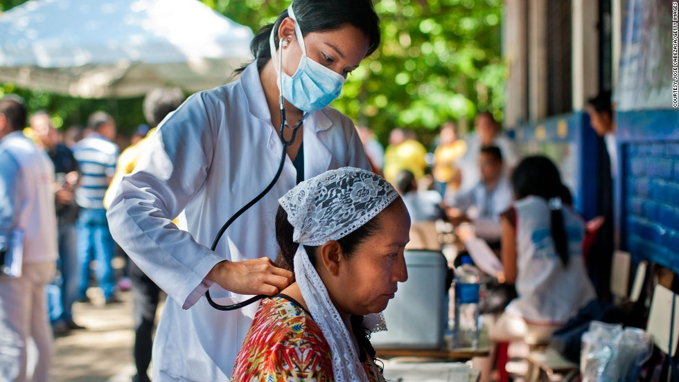 It's a disease with an exotic name, painful symptoms and no treatment or vaccine. It's endemic in Asia and Africa, and it recently spread to the Americas -- where nearly 1 million people have been infected and 150 have died. Here, a doctor examines a patient in El Salvador for signs of Chikungunya.