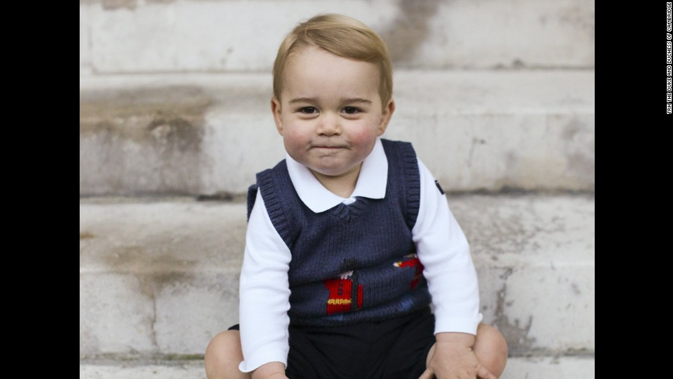 In December 2014, the family released official Christmas photographs of Prince George. Here, he poses in a courtyard at Kensington Palace.