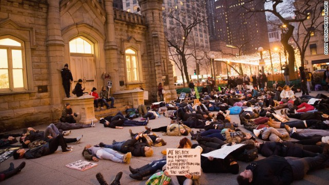 "Protestors stage a ""die-in"" during a march Chicago on December 13."