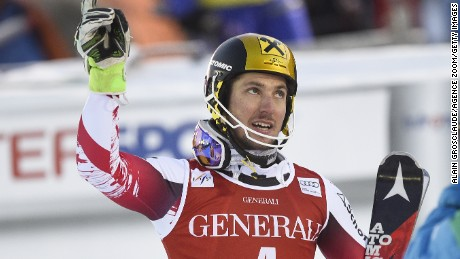 Marcel Hirscher holds his arms aloft after completing a double triumph in World Cup events in Are in Sweden.