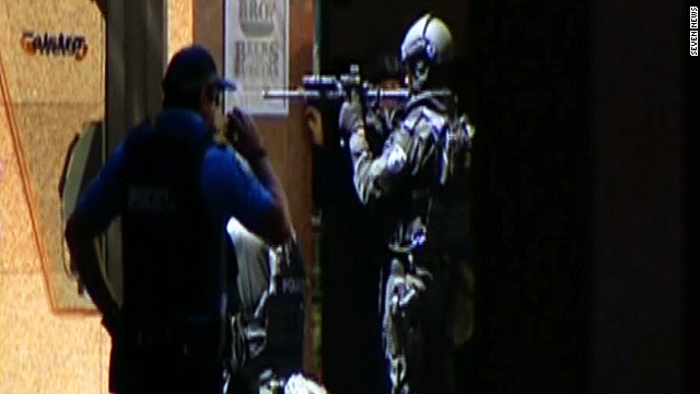 Witness: Woman screamed, 'He has a gun'