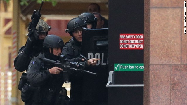 Armed police are seen outside the Lindt Cafe on December 15.