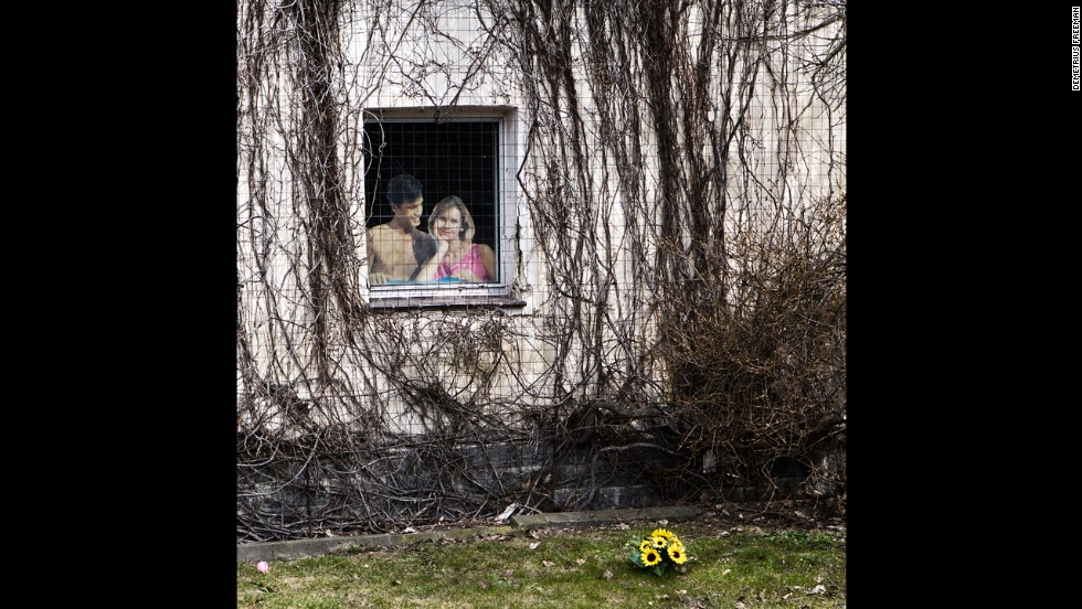 "A paper cutout sits in the window of a home that's scheduled to be demolished for coal mining operations. It's one of Freeman's favorite photos: ""It promoted this perfect couple and a perfect world, when it really wasn't perfect."""