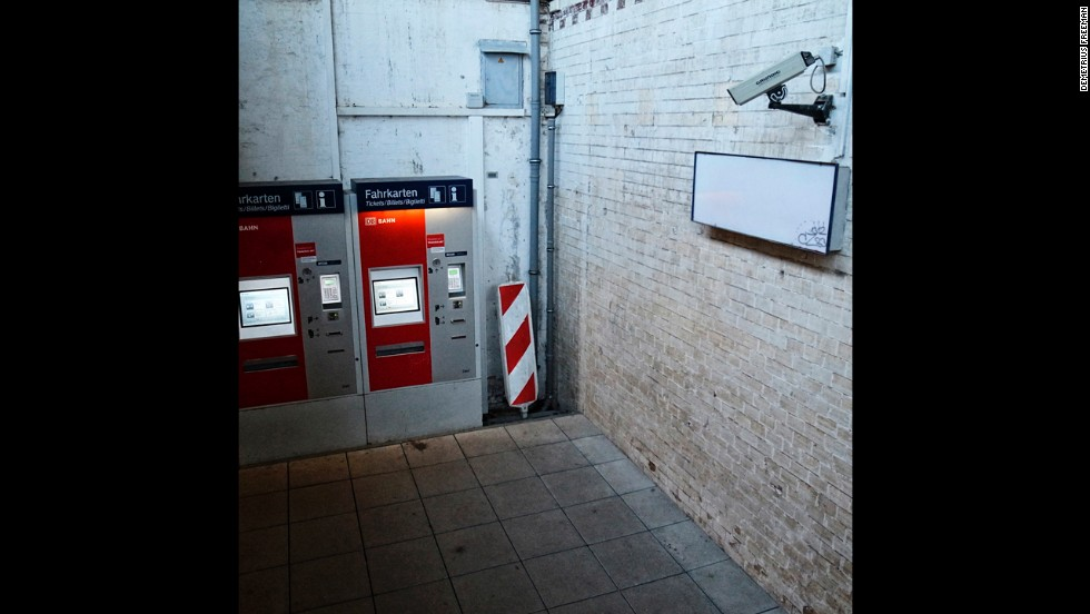 A security camera watches lonely ticket machines at the Hoyerswerda train station.