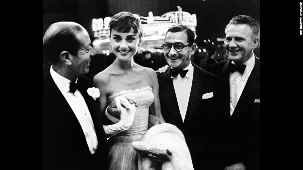 From left, Cole Porter, Audrey Hepburn, Irving Berlin and an unidentified man in the early 1950s.
