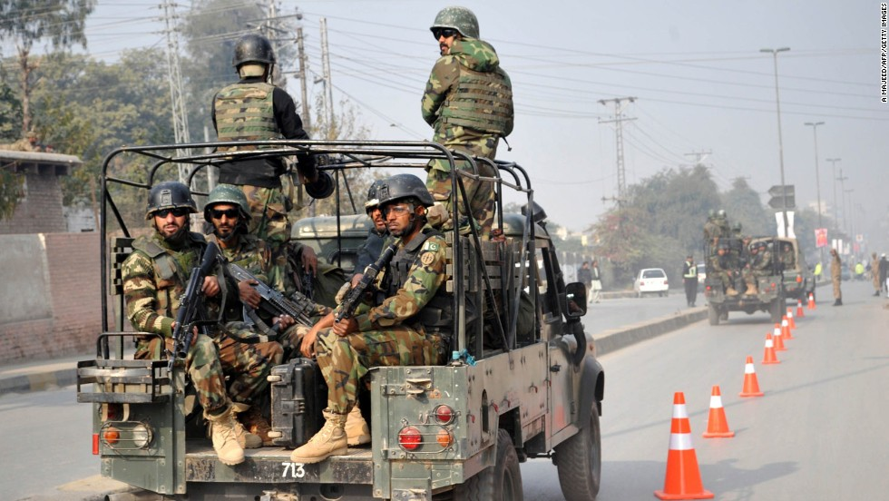 Pakistani troops reach the site of the attack.