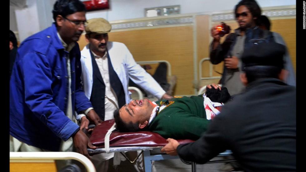 Hospital staff transport an injured student in Peshawar.