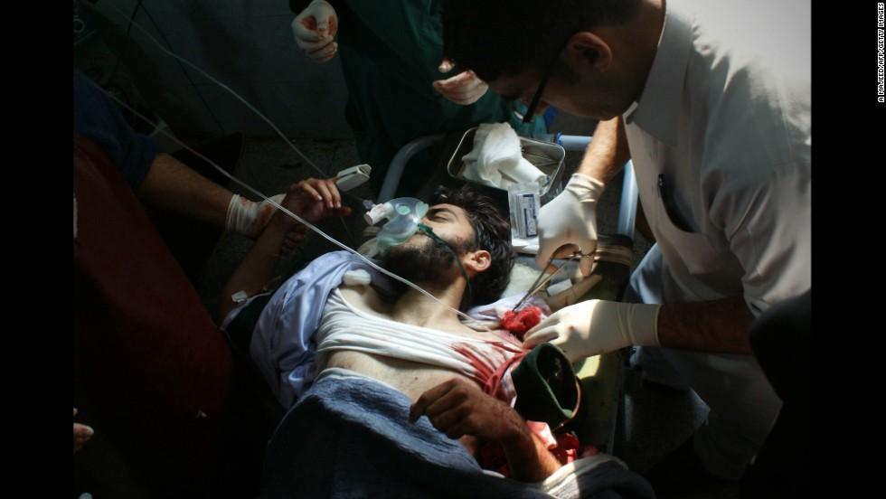 A wounded student receives treatment at a Peshawar hospital.