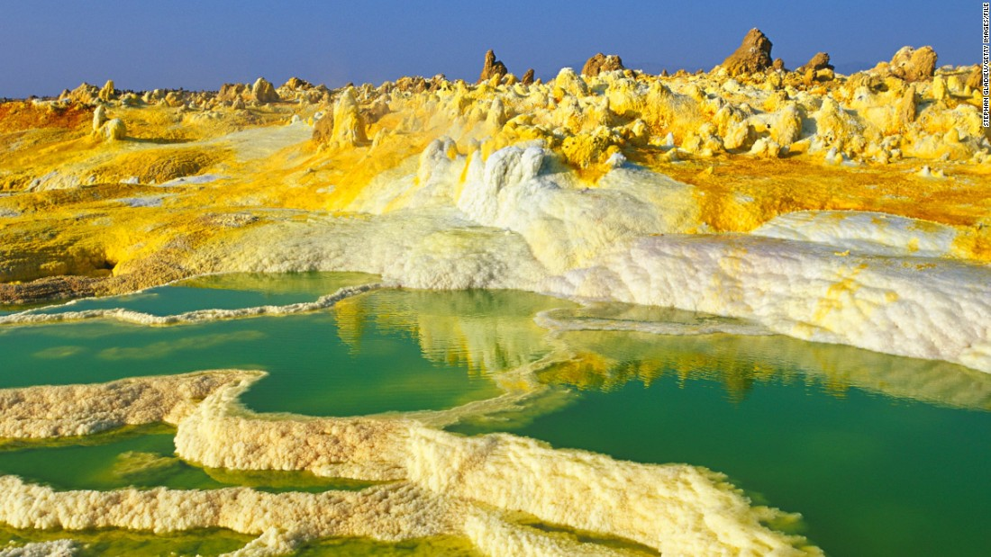 Mother Nature is not afraid to go technicolor for the right effect. These eye-catching landscapes are among the world's most vivid. Some are completely natural, while others have been helped along by humans. It's no easy feat to reach many of these spots, but they're all worth a closer look. <br /><strong><br />Dallol, Ethiopia </strong><br /><br />The Dallol hydrothermal field is northeast of the Erta Ale Range in one of the lowest and hottest areas of the desolate Danakil Depression in Ethiopia. The Dallol craters are the Earth's lowest known subaerial volcanic vents. Salty hot springs featuring a rich palette of colors dot the area. There are hot yellow sulphur fields among the white salt beds.
