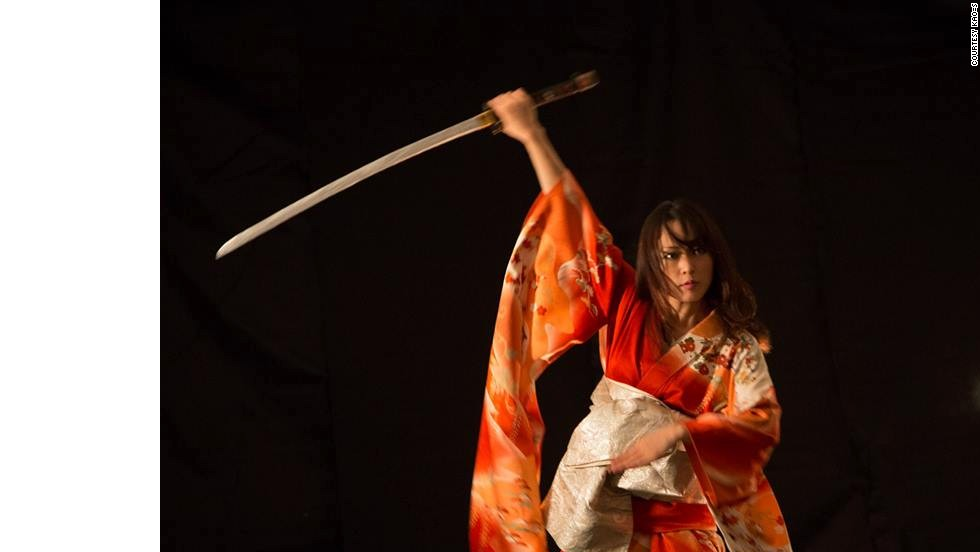 Kaori Kawabuchi is the heart of the band as lead vocalist and sword master. She displays incredible agility and force during her dynamic and intense katana samurai dances and helps the band translate their musical ambitions through the art of movement to a new level.