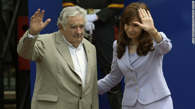 Uruguay's President Jose Mujica and Argentina's Cristina Fernandez wave to the press during the 47th Mercosur Summit, in Parana, Entre Rios, Argentina on December 17, 2014. AFP PHOTO / Juan Mabromata (Photo credit should read JUAN MABROMATA/AFP/Getty Images)