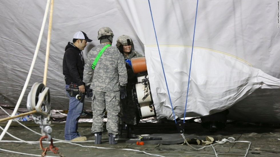 Crew check the inflation of the Army aerostat.