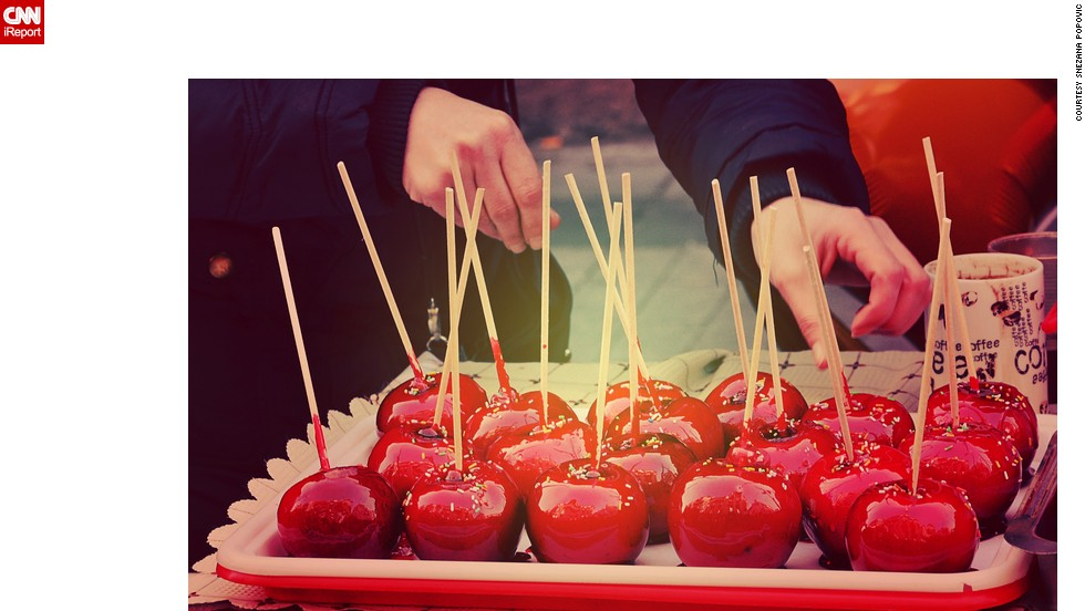 "<strong>Candied apples:</strong> Snezana Popovic says <a href=""http://ireport.cnn.com/docs/DOC-1195382"">candied apples</a> are an indispensable part of street celebrations in Serbia. She took this photo at the ""Street of Open Heart"" event which is organized every January 1 at several locations in the Serbian capital of Belgrade."