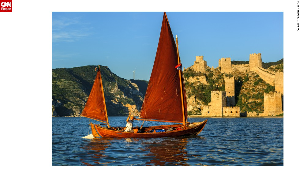"<strong>Golubac Fortress</strong>: Dragan Miletic took this photo of a colorful boat on the river Danube, with the medieval <a href=""http://ireport.cnn.com/docs/DOC-1191741"">Golubac fortress</a> bathed in golden light in the background."