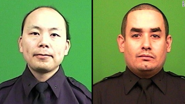 New York police officers Wenjian Liu, left, and Rafael Ramos.