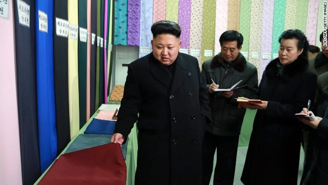 "This undated picture released from North Korea's official Korean Central News Agency (KCNA) on December 21, 2014 shows North Korean leader Kim Jong-Un (L) visiting the Kim Jong-Suk Pyongyang Textile Mill in Pyongyang.    AFP PHOTO / KCNA via KNS    REPUBLIC OF KOREA OUT  THIS PICTURE WAS MADE AVAILABLE BY A THIRD PARTY. AFP CAN NOT INDEPENDENTLY VERIFY THE AUTHENTICITY, LOCATION, DATE AND CONTENT OF THIS IMAGE. THIS PHOTO IS DISTRIBUTED EXACTLY AS RECEIVED BY AFP.  ---EDITORS NOTE--- RESTRICTED TO EDITORIAL USE - MANDATORY CREDIT ""AFP PHOTO / KCNA VIA KNS"" - NO MARKETING NO ADVERTISING CAMPAIGNS - DISTRIBUTED AS A SERVICE TO CLIENTSKNS/AFP/Getty Images"