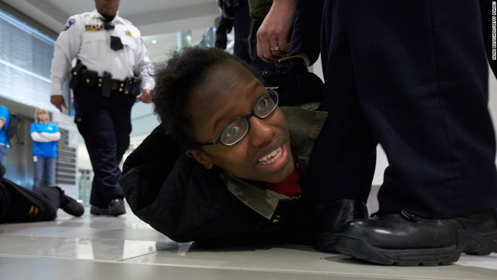 "Police arrest a ""Black Lives Matter"" protester on Saturday, December 20, in Bloomington, Minnesota. Invoking the familiar names of blacks who died at the hands of police, including Eric Garner, Michael Brown and Tamir Rice, thousands have taken part in protests across the country calling for a more aggressive federal response to recent slayings by police."