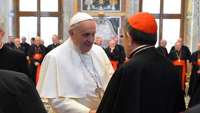 Pope Francis meets with Cardinals and Bishops of the Vatican Curia on the occasion of the exchange of Christmas greetings in the Clementine hall at Vatican, Monday, Dec. 22, 2014. (AP Photo/Andreas Solaro, Pool)