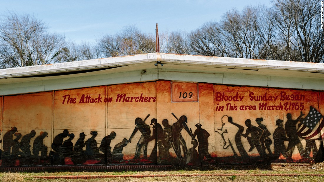 "A mural on a building at the foot of the Edmund Pettus Bridge commemorates Bloody Sunday. Some scenes for the movie ""Selma"" were filmed near this building."
