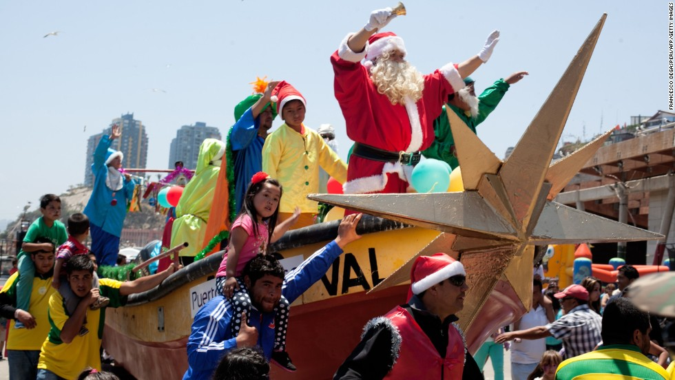 A fisherman in Santa disguise joins in the holiday celebrations December 24 in Valparaiso, Chile.
