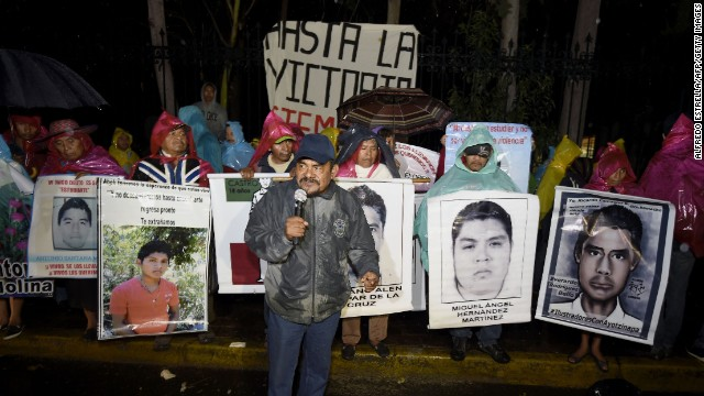 Felipe de la Cruz, father of one of the 43 missing students, addresses protesters on Christmas Eve outside the official Los Pinos residence of Mexican President Enrique Pena Nieto in Mexico City on December 24, 2014. The missing students disappeared on September 26th, when police in the city of Iguala attacked busloads of college students, allegedly under the orders of its mayor, and handed them over to a gang. AFP PHOTO / ALFREDO ESTRELLA (Photo credit should read ALFREDO ESTRELLA/AFP/Getty Images)