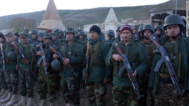 Iraqi Kurdish Peshmerga fighters gather in Sinjar, west of the northern Iraqi city of Mosul on December 21, 2014 after an operation which broke the second Islamic State jihadist group (IS) siege of Mount Sinjar this year. The operation threatens the links between the city of Mosul, the main IS stronghold in Iraq, and territory the militant group controls in neighbouring Syria.