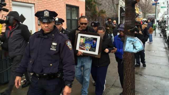 Visitors pay respects to two slain police officers this week at a memorial in New York's Bedford-Stuyvesant neighborhood.