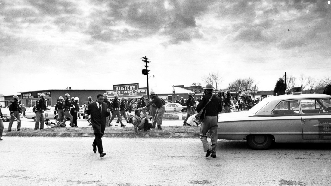 Civil rights leaders Hosea Williams (wearing a suit) and John Lewis (on the ground) led the march on that Sunday afternoon. Lewis, who has been a congressman from Georgia since being elected in 1986, was badly injured in Selma, suffering a fractured skull after being beaten by troopers.