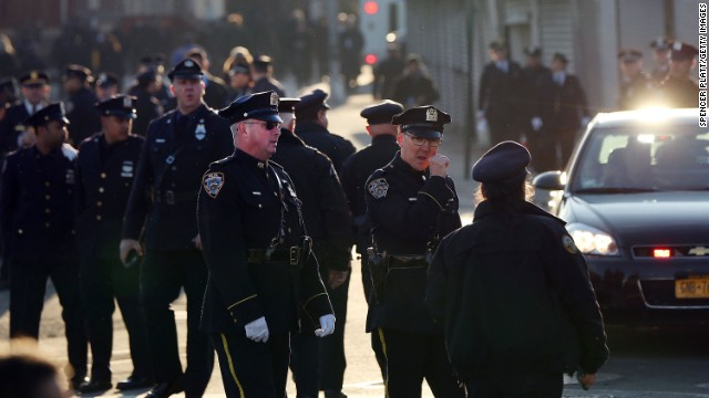 Police officers gather outside of Christ Tabernacle Church for the funeral of slain New York City Police Officer Rafael Ramos.
