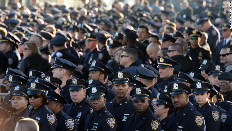 Thousands of police officers gathered to pay their respects outside the church.