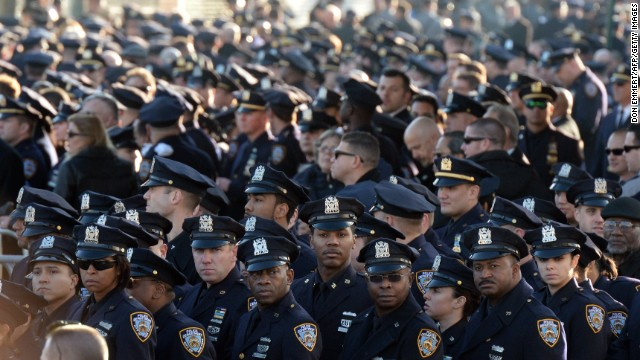 Police officers gather for the funeral for New York police officer Rafael Ramos in New York.