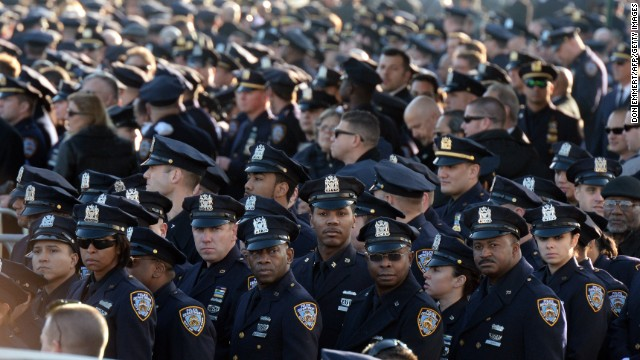 Police officers gather for the funeral for New York police officer Rafael Ramos on December 27, 2014 in New York. Thousands of people, including US Vice President Joe Biden, attended the funeral Saturday for Ramos, one of two New York officers shot dead in apparent revenge for recent police killings of unarmed black men. Ramos was shot alongside his partner Wenjian Liu on December 20 on the heels of nationwide protests accusing police of racism and using excessive force against black people.  AFP PHOTO/DON EMMERT        (Photo credit should read DON EMMERT/AFP/Getty Images)