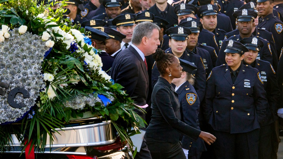 New York City Mayor Bill de Blasio and his wife, Chirlane McCray, arrive for the funeral.