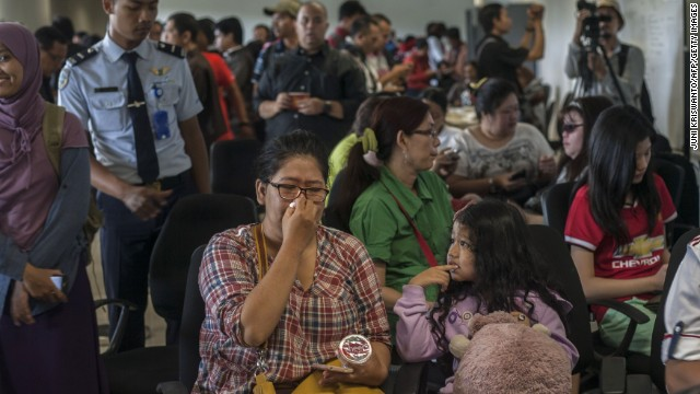 Family members of passengers of missing Malaysian air carrier AirAsia flight QZ8501 gather at Juanda international airport in Surabaya in East Java on December 28, 2014 hours after the news the flight went missing. The AirAsia Airbus plane with 162 people on board went missing en route from Indonesia to Singapore early on December 28, officials and the airline said, in the third major incident to affect a Malaysian carrier this year.   AFP PHOTO / Juni KRISWANTO        (Photo credit should read JUNI KRISWANTO/AFP/Getty Images)