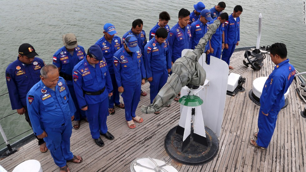 Members of Indonesia's Marine Police pray before a search operation on December 29.