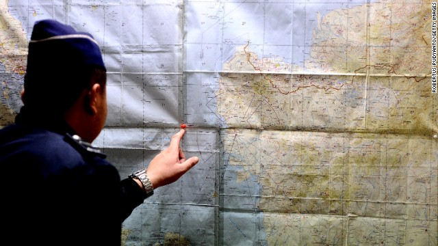 An Indonesia Search and Rescue officer inspects the operational air navigation map during the investigation of missing Air Asia QZ8501 at Juanda International Airport in Surabaya, Indonesia on December 28, 2014.