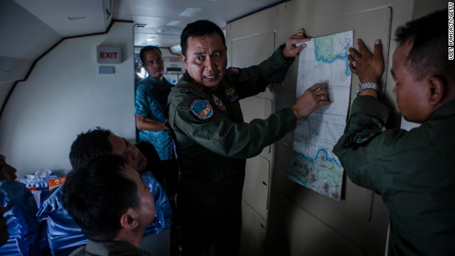 A member of the Indonesian military reads a map during a search and rescue (SAR) mission over the waters of the Java Sea near Pangkalan Bun, Kalimantan on December 30, 2014 in Surabaya, Indonesia.