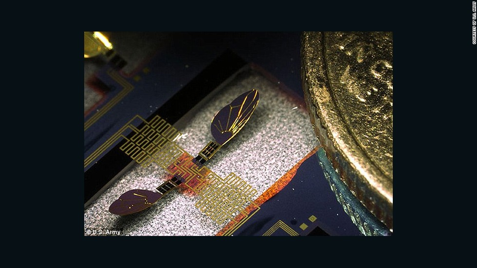 A 'robo-fly' seen next to the edge of a dime for scale. While the team has shown that the project works in principle, it may take a further 10-15 years of research before the Army has a fully functional robotic surveillance insect. Researchers say more work is needed to establish algorithms that would allow a robotic insect to stabilize itself.