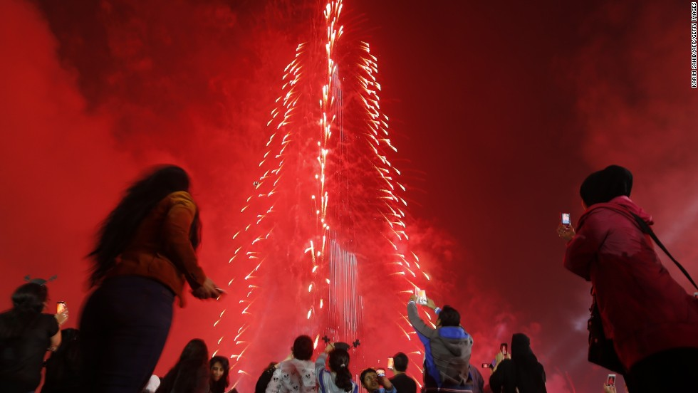 People in Dubai, United Arab Emirates, celebrate the new year with a light-and-sound extravaganza at the Burj Khalifa, the world's tallest skyscraper. The tower was lit up with colored panels as the clock counted down to 2015.