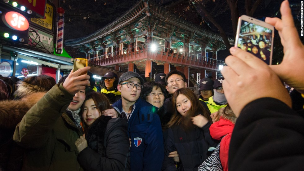 People in Seoul, South Korea, celebrate the new year with a bell-ringing ceremony at the Bosingak Belfry.