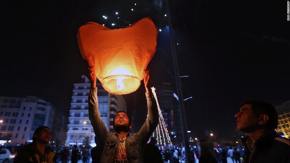 A  celebrant holds a heart-shaped balloon during the New Year's celebrations in downtown Beirut, Lebanon.