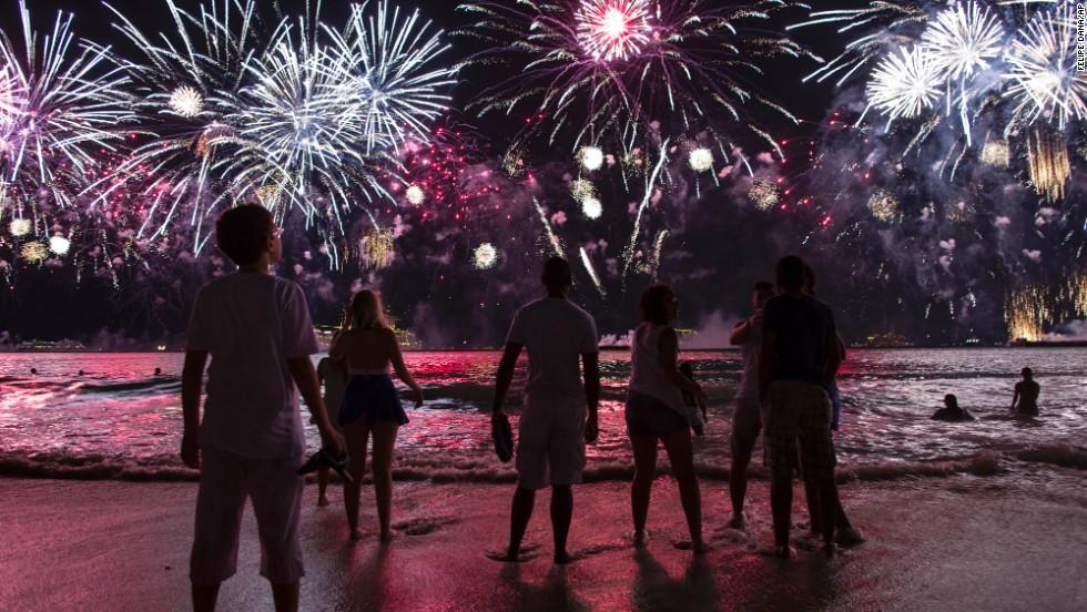 People watch fireworks from Copacabana beach.