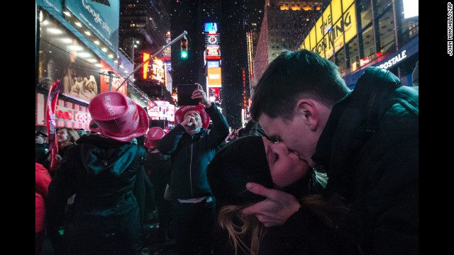 Sean Reilly and Emily Verselin kiss at midnight in Times Square.