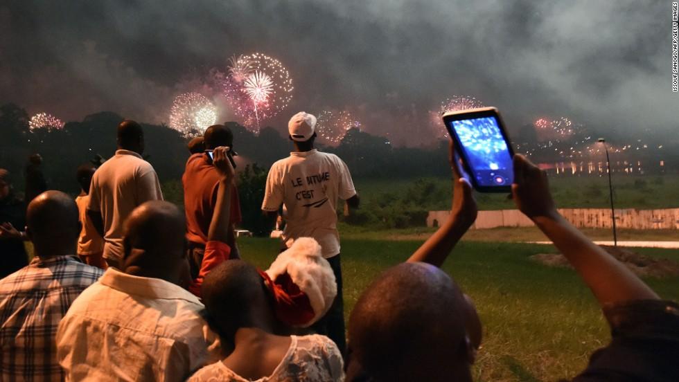 Fireworks illuminate the night sky over the Ebrie Lagoon in Abidjan, Ivory Coast.
